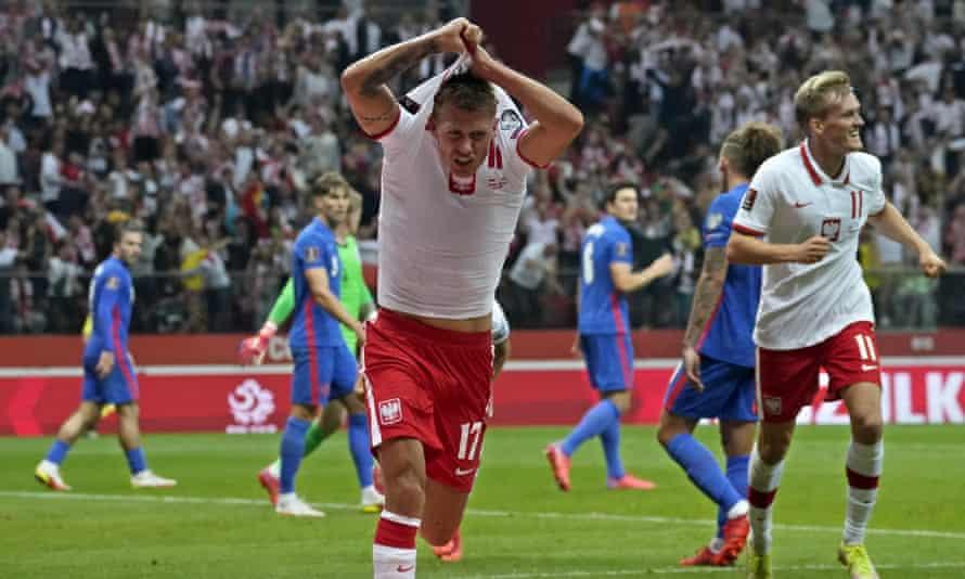 Damian Szymanski celebrates Poland's late equaliser against England in Warsaw.