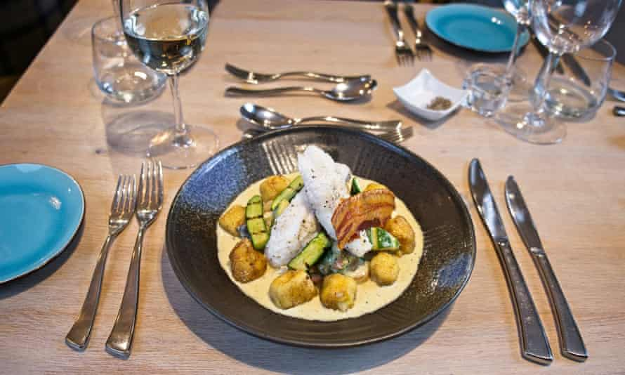 Monkfish Tail with Gnocchi Potato, Wild Mushrooms, Pancetta, White Wine and cream, at the Ginger Peanut
