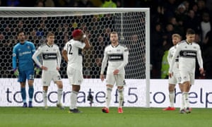 Fulham players look dejected after Will Hughes' goal.