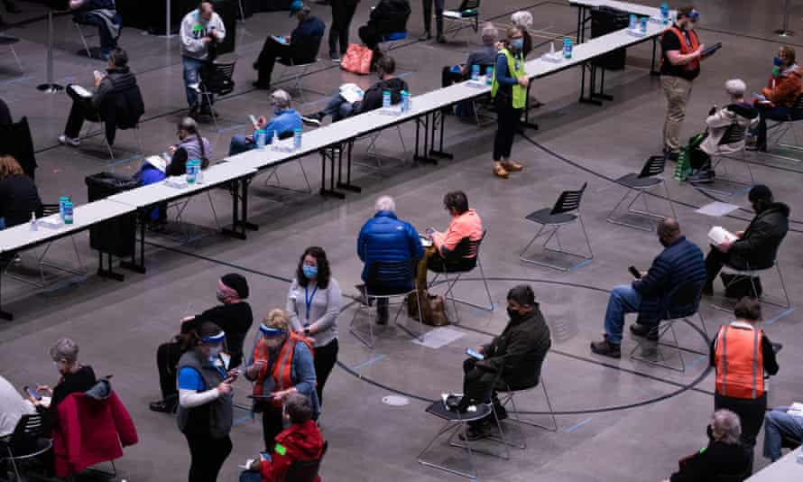 Patients wait and are observed for an adverse reactions following their first dose of the Covid-19 vaccine at the Amazon Meeting Center in downtown Seattle.