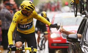 Froome has the traditional winners glass of champagne on the last stage.
