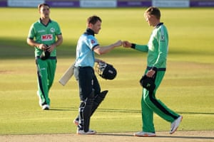 England's Eoin Morgan (centre) fist bumps with Ireland's Harry Tector at the end of the match.