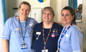 Three nurses pose at a hospital in Sunderland. One was praised for sleeping over at her place of work.