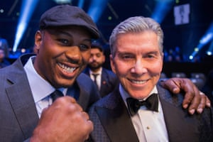 Lennox Lewis poses with ring announcer Michael Buffer