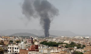Smoke rises from the damaged factory in Sana'a