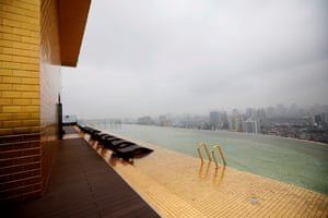 A view of the gold-coloured infinity pool