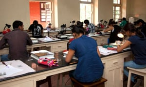 Indian students taking an exam. Protests erupted after students' sleeves were cut off before exams in Muzaffarpur.