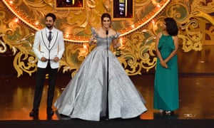 Kriti Sanon receives an award from Ayushmann Khurrana, left, and Deepika K, right, at last year's IIFA in Bangkok.