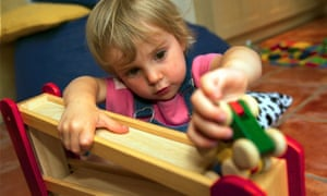 A child plays in a nursery.