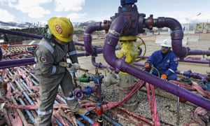 Workers tend to a well head during a hydraulic fracturing operation in western Colorado.