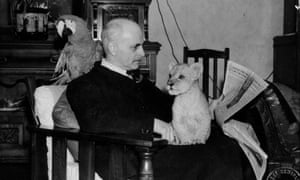 George Mottershead with a parrot and cub