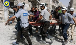 Rescue workers come to the aid of civilians after an airstrike on the al-Sakhour neighbourhood in rebel-held eastern Aleppo, Syria.