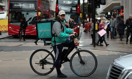 Deliveroo cyclist on Oxford Street, London.