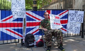 A Somerset man, Nick, protests outside Downing Street over delays to universal credit payments which have left him homeless twice.