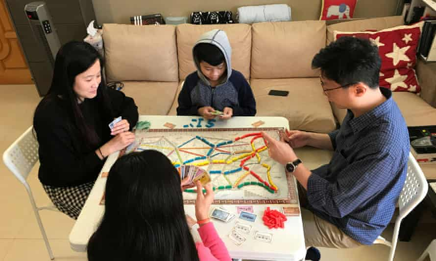 A family in Hong Kong play board games amid the coronavirus outbreak.