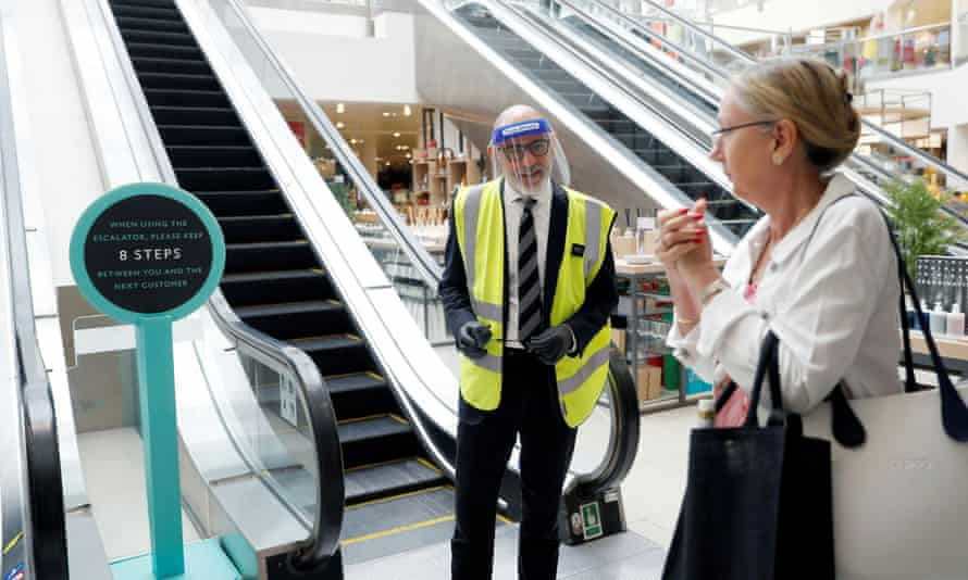 A John Lewis partners talks with a customer in Kingston, west London