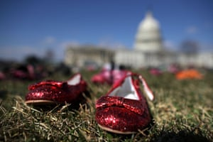 Seven thousand pairs of shoes, representing the children killed by gun violence since the mass shooting at Sandy Hook Elementary School in 2012, are spread out on the lawn on the east side of the US Capitol in Washington, DC. Organized by the online activist group Avaaz, the shoes are intended to urge Congress to pass gun-reform legislation.