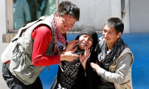Relatives of the victims mourn at a hospital after a suicide attack in Kabul