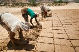 Men making mud-bricks on the outskirts of Shibam.