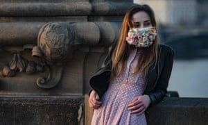 CZECH-HEALTH-VIRUS<br>A woman wearing a face mask stands on the Charles Bridge on March 28, 2020, in Prague, where most activities slowed down or came to a halt due to the spread of the novel coronavirus COVID-19. (Photo by Michal Cizek / AFP) (Photo by MICHAL CIZEK/AFP via Getty Images)