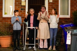 Barbara Leigh, 93, rings a bell for the NHS with her family – who are all staying together throughout the lockdown – from their front garden, across the road from Wythenshawe hospital, Manchester