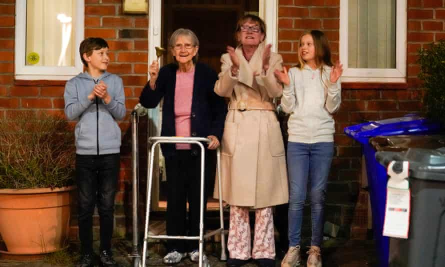 Barbara Leigh, 93, (second left) rings a bell for the NHS, with her family  in Manchester.