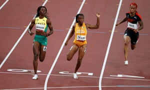 Shericka Jackson of Jamaica and Marie-Josee Ta Lou of Ivory Coast cross the line ahead of Michelle-Lee Ahye of Trinidad & Tobago (right).