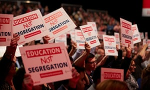 Labour-branded placards reading 'Education not segregation'