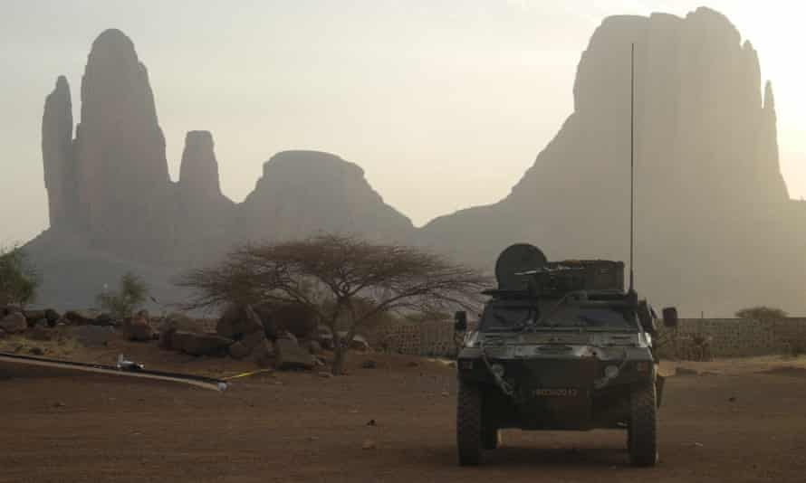 A French armoured vehicle drives by Mount Hombori during operations in Mali's Gourma region in 2019.