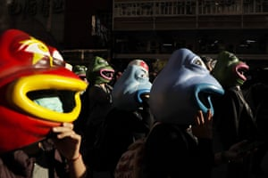 Hong Kong: people wearing Pepe the Frog-shaped headgear take part in a pro-democracy march