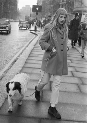 A young woman and her dog on the march