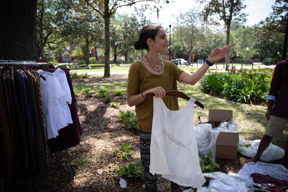 Kira Janock organizes clothes being given away for free at the Krishna lunch on the Plaza of the Americas on University of Florida's campus in Gainesville.