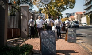 Workers of a restaurant in Johannesburg demonstrate against the Covid-19 lockdown