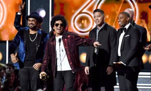 Bruno Mars and production team The Stereotypes accept the record of the year award onstage during the 60th annual Grammy awards.