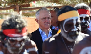 Australian Prime Minister Malcolm Turnbull is surrounded by aboriginal dancers as he attends the Kenbi Native land claim ceremony near Darwin, Tuesday, June 21, 2016.