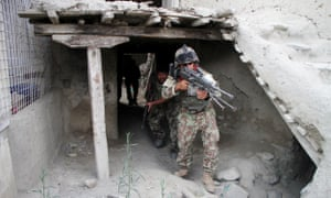 Afghan soldiers take part in a military operation against the Islamic State in Kot district of Nangarhar province, Afghanistan, on Tuesday.