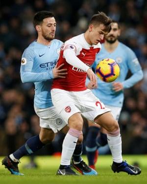 Arsenal's Denis Suarez shields the ball from David Silva