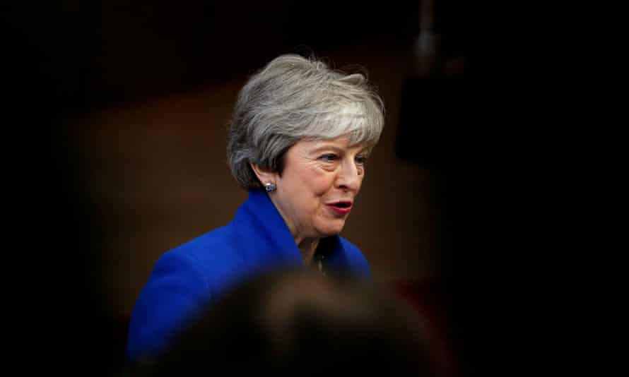 Theresa May arrives at an extraordinary European Union leaders summit in Brussels.