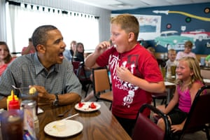 """5 July: '""""Anyone want to try a piece of my strawberry pie?"""" the president asked those at adjacent tables during a stop for lunch at Kozy Corners restaurant in Oak Harbor, Ohio. A young boy said yes and came over for a big bite of pie'"""