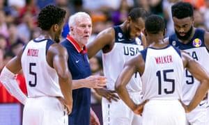 USA head coach Gregg Popovich talks to Kemba Walker.