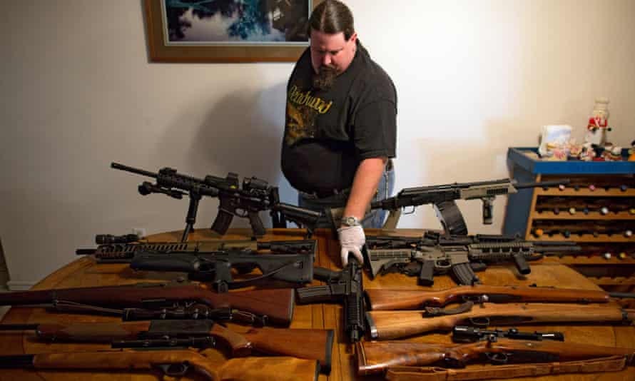 Fred, who has a collection of more than 40 firearms, lays out some of his rifles for a photo.