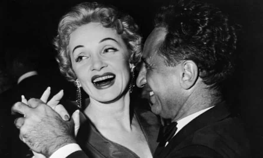 Marlene Dietrich dances with Elia Kazan, who provided Congress with a list of supposed Communists in Hollywood.
