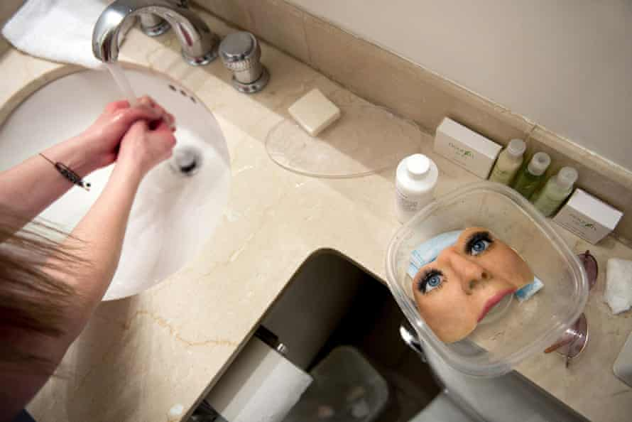 Michelle Fox prepares to put on her prosthetic face.