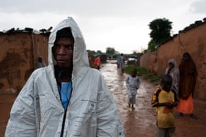 A man shelters from the rain in the Kuraketa IDP camp in Damaturu.