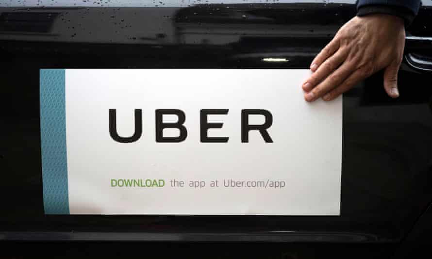 Uber sign on side of car