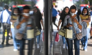 Shoppers on Oxford Street in London.  Nine in 10 areas in the UK have seen a week-on-week rise in Covid cases.