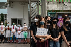 Hong Kong: Students and alumni stand outside Kit Sam Lam Bing Yim secondary school in a pro-democracy protest