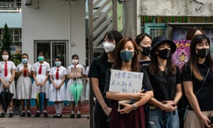 Students form a human chain during a protest on Thursday in Hong Kong. Carrie Lam has backed police to handle the protests despite claims of brutality.