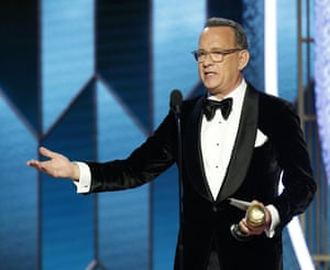 Tom Hanks accepts the Cecil B DeMille award.
