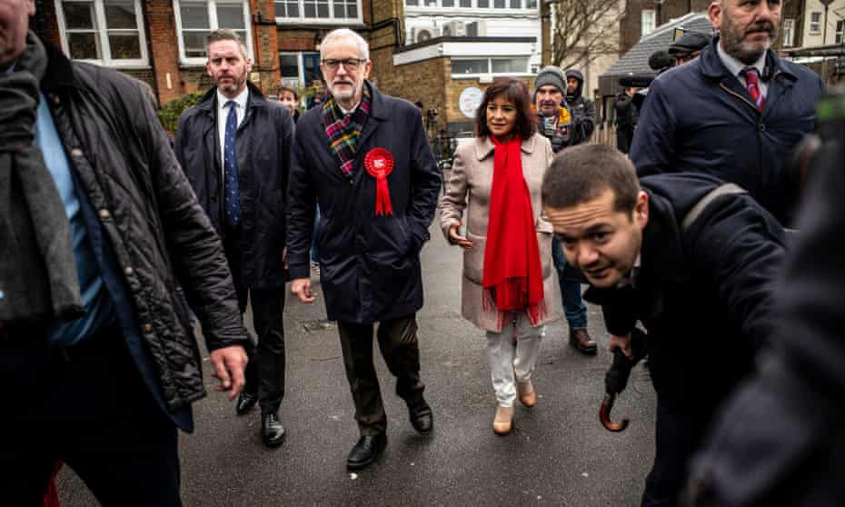 Jeremy Corbyn his wife, Laura Alvarez, outside their local polling station.